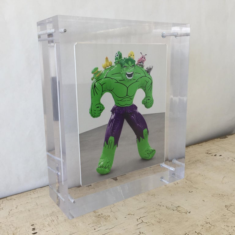 Accompanied with Gagosian catalogue of Featured Exhibitions; this four inch acrylic encases the original invitation announcement to Jeff Koons: Hulk Elvis exhibition (Signed). This giant block will display beautifully like a piece of art adding to