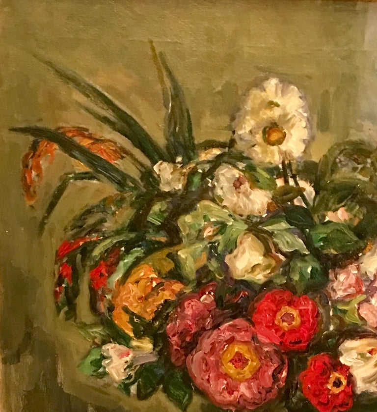 Vividly colorful and classically composed, yet loosely painted, this original still life oil on canvas painting of flowers in a vase on a table is a fine example of the work of famous, listed, deceased American Impressionist painter, Louis Ritman.