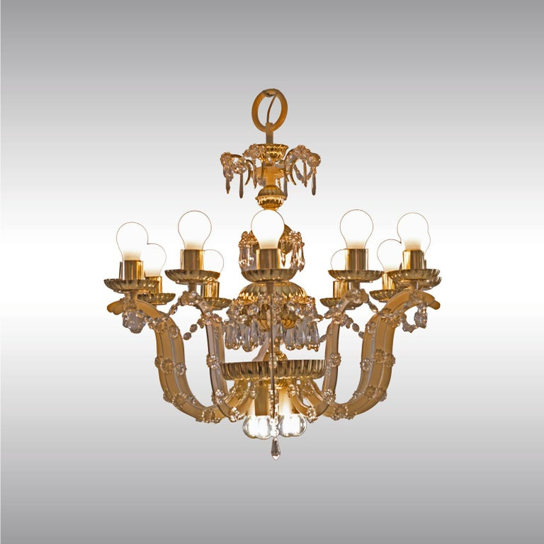 Magnificent chandelier from circa 1960, Mid-Century Modern, chased parts in brass and glass-application.
