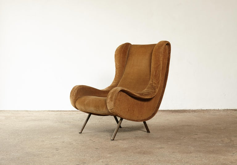An authentic Marco Zanuso senior chair, Arflex, France/Italy, 1960s. Fabric is worn and filling expired so this is sold for re-upholstery in customer's choice of fabric.     Ships worldwide.
