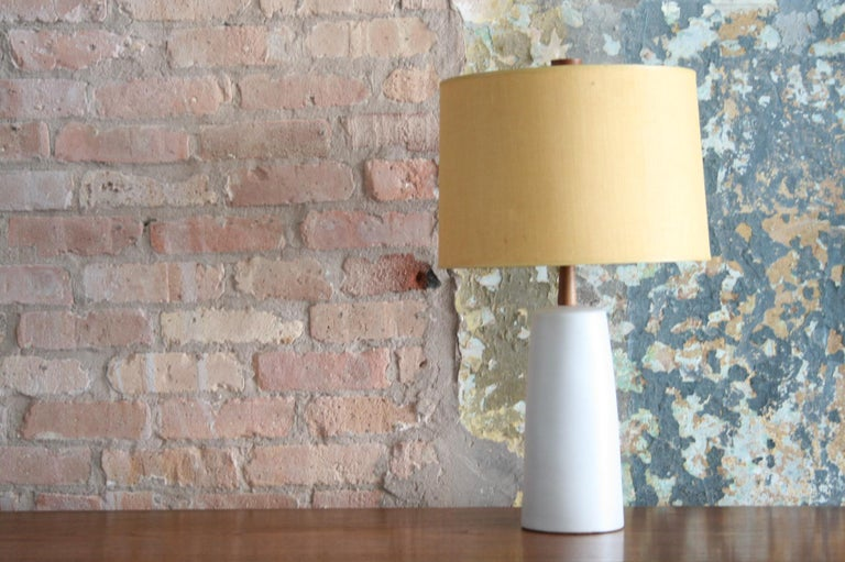 These rich and vivid glazed ceramic pottery table lamps were designed by Jane & Gordon Martz for Marshall Studios. Each is topped with original handmade Beige burlap shades and feature an original walnut finial with a base in a white beautiful matte