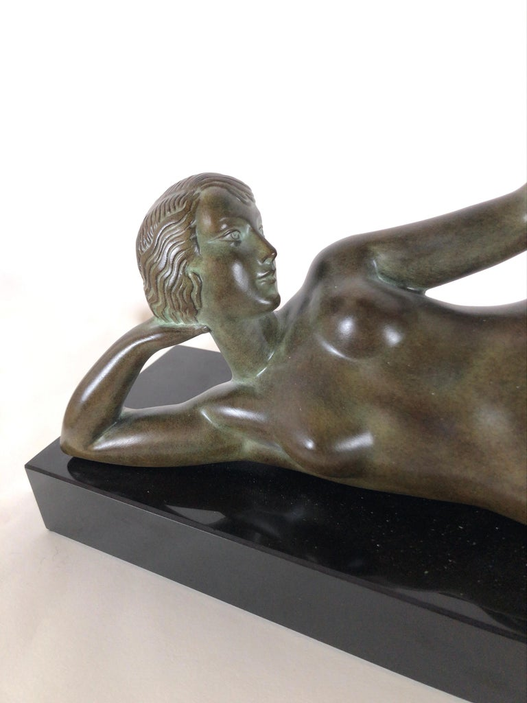 Patinated Original Max Le Verrier Lighted Sculpture Aube in Art Deco Style For Sale