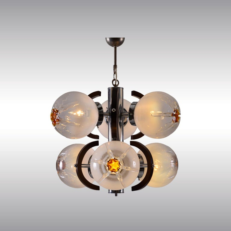 Futuristic chandelier in the typical style of the 1960s-1970s. Material used is brass nickel-plated, handblown glasses, artistic works. Measures: Length 65 cm (25.59 inch) Ø 55 cm (21.65 inch) Sockets 6 x Edison screw sockets E26/E27 for