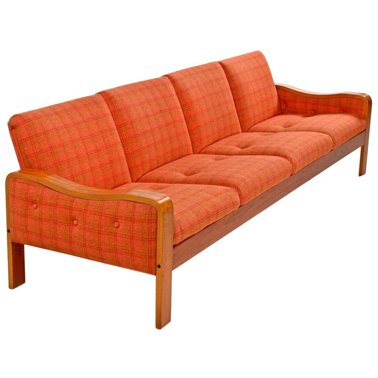 This sofa is in absolutely stunning original condition. A rare time capsule home treasure. We typically restore all of our upholstered finds, but this couch was in such outstanding condition that we decided to leave the original plaid wool fabric.
