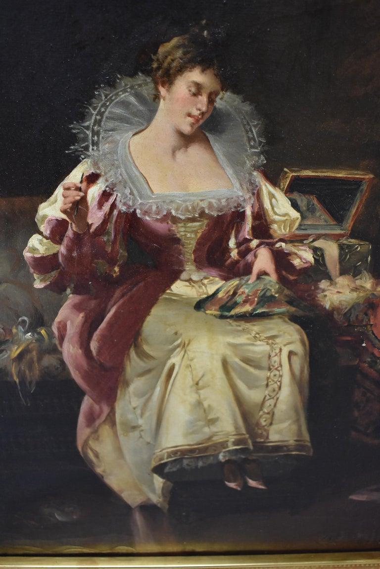 Original oil on canvas by Spanish artist Manuel Mendez 1843-1909. Lady doing needlepoint in a rose velvet dress with high lace collar. Ornate openwork gold frame. Old gallery sticker on the back.