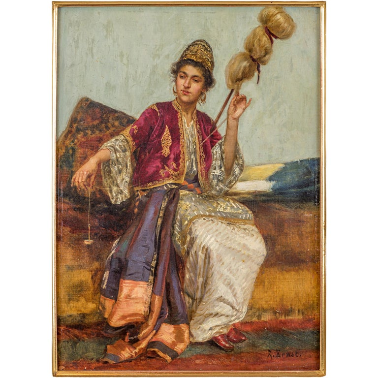 A Beautiful orientalist painting depicting a beautiful young woman with a spool spinner.  Rudolf Ernst travelled to Spain, North Africa, Turkey and Egypt in the late nineteenth century and he became fascinated with Islamic culture and his paintings