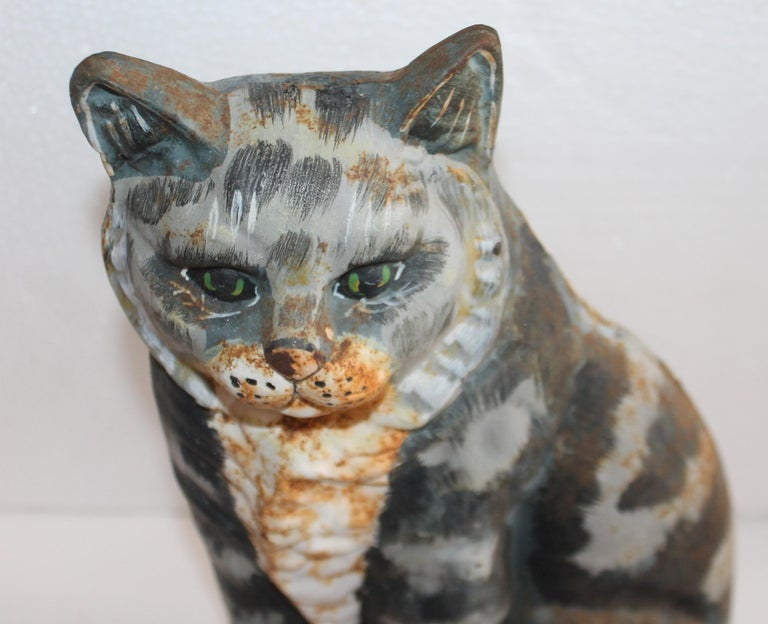 This fun original hand painted iron cat door stop. There is minor rust but nice patina.