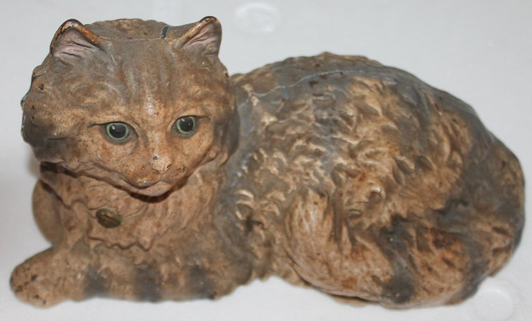 This early and original painted signed Hubley cast iron cat door stop. The painted surface is the very best.