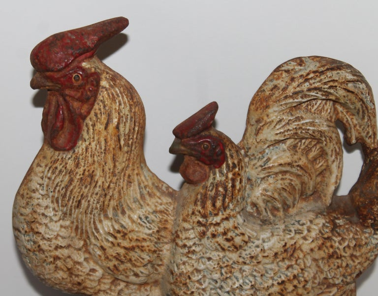 This folky original painted double roosters cast iron door stop. Fantastic patina and undisturbed surface.