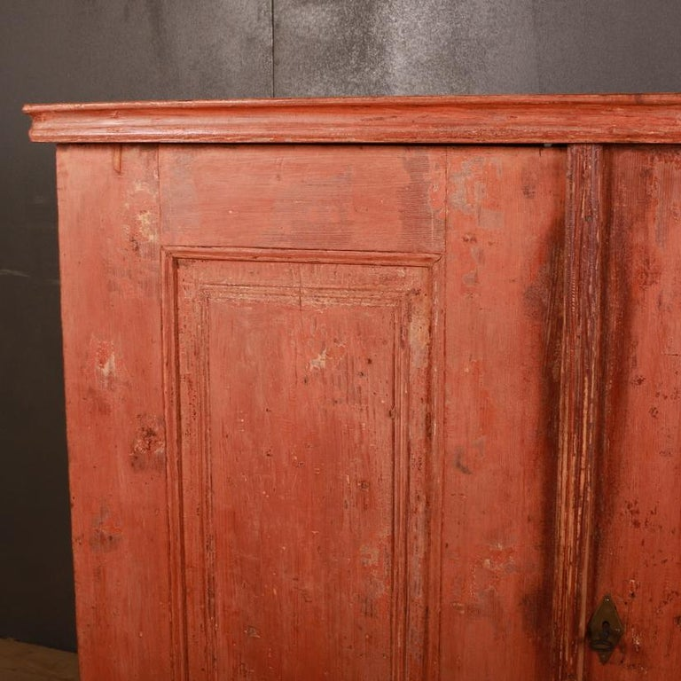 Early 19th century Swedish 2-door buffet scraped back to the original paint finish. Interior fitted with 2 drawers and shelves, 1810