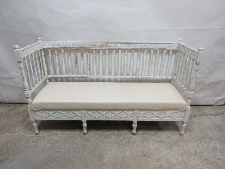 This is a 100% original painted Swedish Gustavian sofa. It has new cushion seating covered in Muslin. This sofa was found at an Auction in Mora, Sweden.