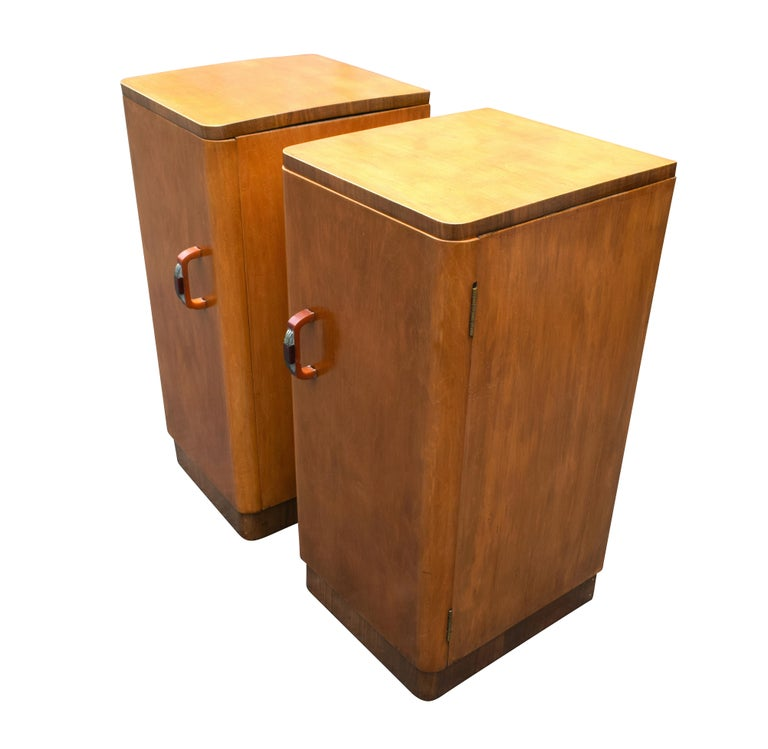 Matching pair of 1930s Art Deco bedside cabinets in a wonderful blonde straight grain beech veneer, with walnut feather banding around the base and top, so easily integrated with modern settings as well as period. Both retain their original