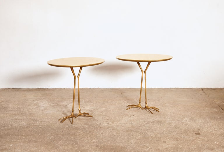 An original pair of 1970s Meret Oppenheim Traccia tables. This pair manufactured by Gavina, Italy in the 1970s. Oval shaped, original gold leaf top featuring bird footprints, on top of patinated cast bronze bird legs. Rarely found as an original
