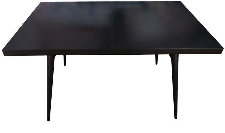Beautiful early 1950s Paul McCobb maple dining table. Great midcentury design. Totally refinished dining table #1522 with 4 tapered legs with dowel supports. All solid maple with fresh black lacquer finish in excellent condition. You are buying (1)