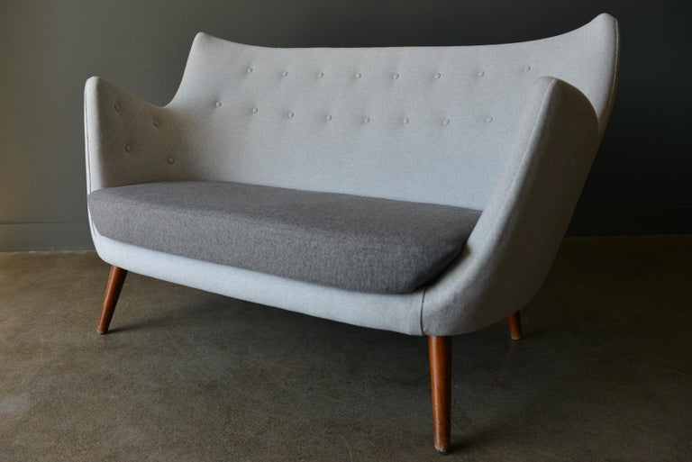 Original poet sofa by Finn Juhl, circa 1941. Original vintage poet sofa first designed in 1941 by Finn Juhl. Meticulously restored to exacting standards with handstitched seams and beautiful, soft wool blend contrasting color block design.