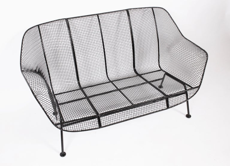 1950s Russell Woodard black sculptural loveseat. Indoor. Outdoor. Classic. Comfortable. Indoor Outdoor seating. Freshly powder coated. Lightly restored. Like new.