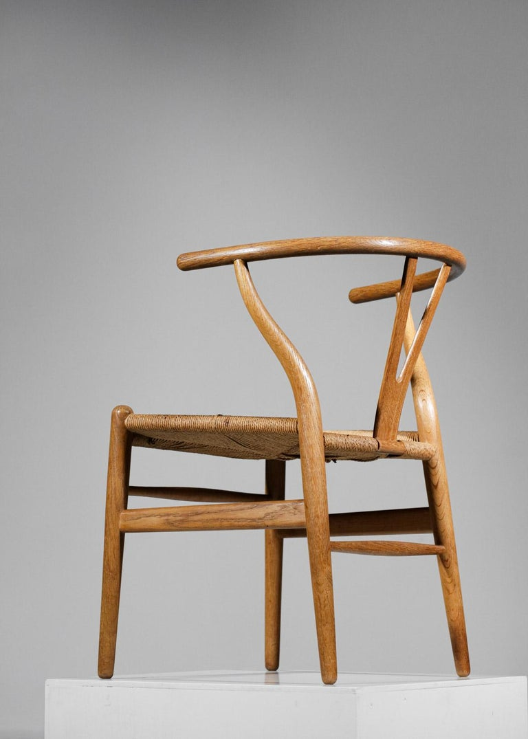 Set of four Scandinavian chairs by the famous Danish designer Hans Wegner designed in 1949 for Carl Hansen & Søn. Known as the CH24 chair or Y chair, it is recognizable by its Y-shaped backrest and bentwood armrests. The frame is made of solid oak,