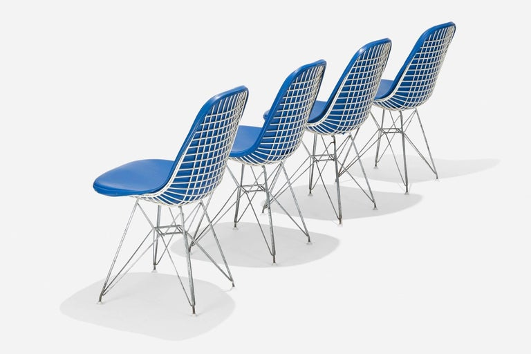 Charles (1907- 1978) and Ray Eames (1912-1988) An exceptional early set of four highly imaginative DKR-1 chairs by Charles and Ray Eames for Herman Miller. In white powder coated and chromed steel, with original blue vinyl seats raised on iconic