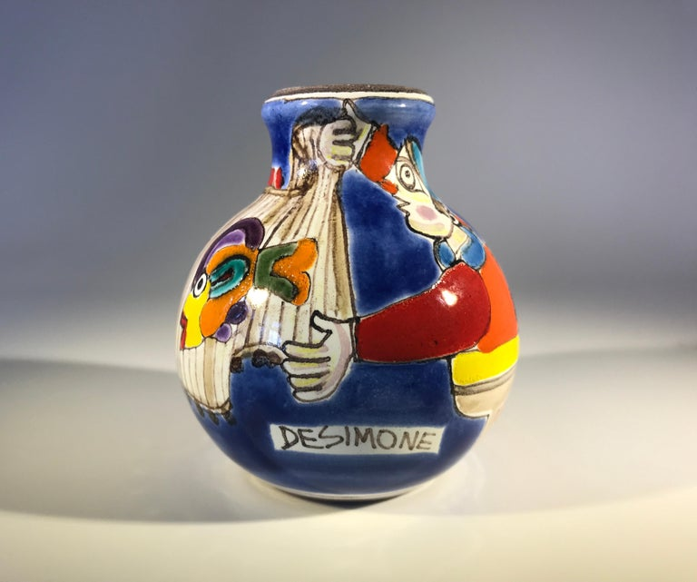 Original and signed by Giovanni Desimone, this hand painted posy vase is full of color and life depicting a busy fisherman Small in size, huge on personality - Giovanni at his best Signed to front by Giovanni Desimone Signed DeSimone Italy on the