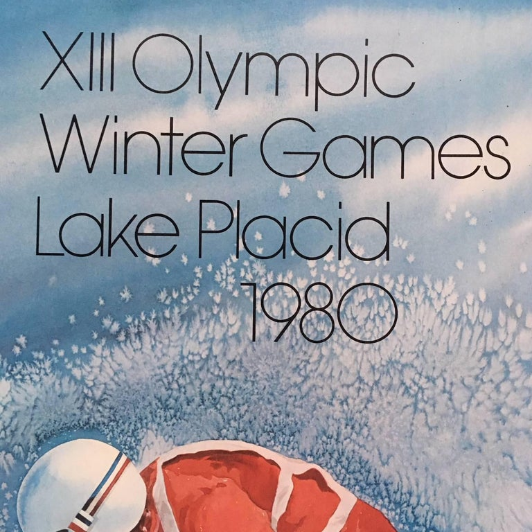 Original skiing poster from the 1980 Lake Placid Olympics, in excellent color and condition as issued on fibercore, with a series of U.S Postal Stamps commemorating the Lake Placid Olympics, adhered to the poster and canceled on the day of issue.