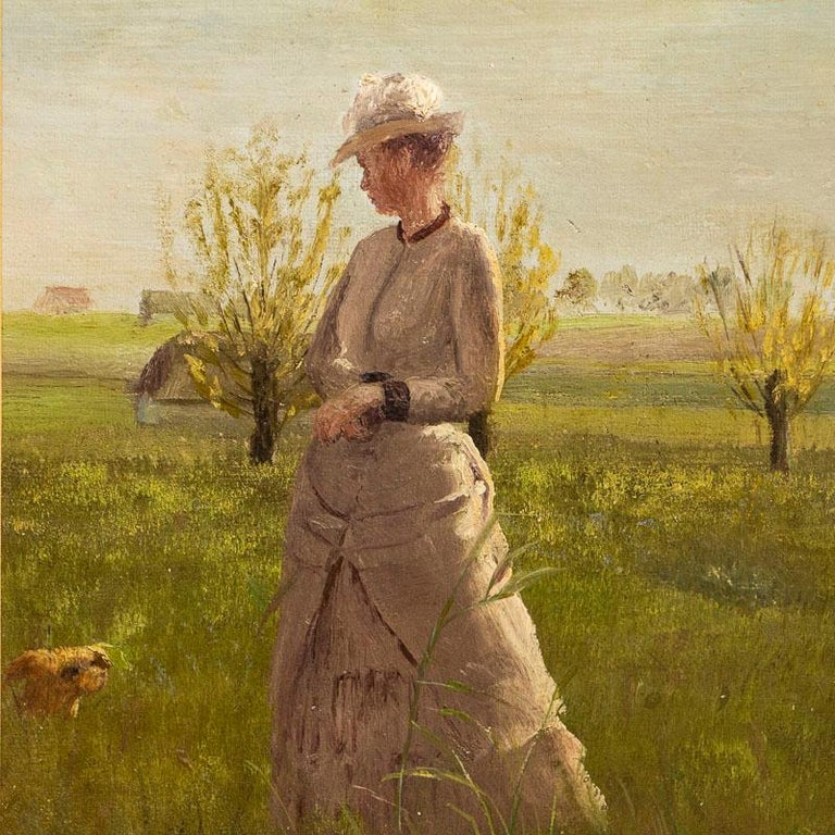 This lovely original oil painting portrays an elegant young woman on a summer day in the country. Look closely as she appears to have a small dog companion at her side. While the painter is unknown, this small painting has been delightfully executed