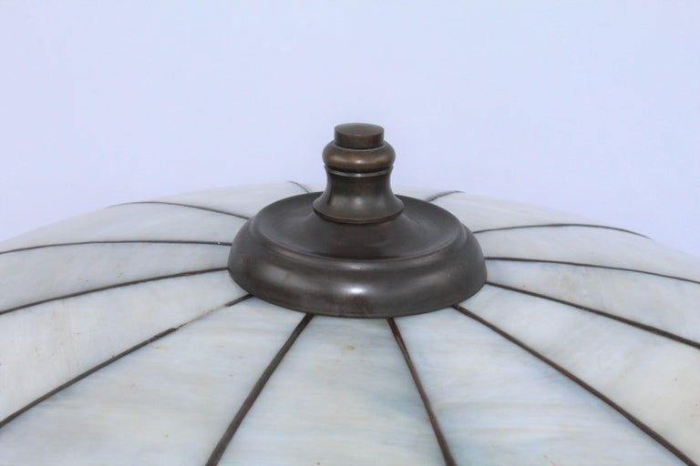 Early American lead glass lamp with double sockets. Has the acorn pull chains. Not original cap and finial. One small piece of foil missing on top about an inch. Easy to repair. No markings anywhere. Size: 18