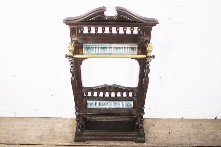A beautiful untouched original Victorian cast iron stick or umbrella stand still in its original finish which has been lightly cleaned and waxed to give a lovely glow. Finley cast spindles support brass rails attached by brass finials. The