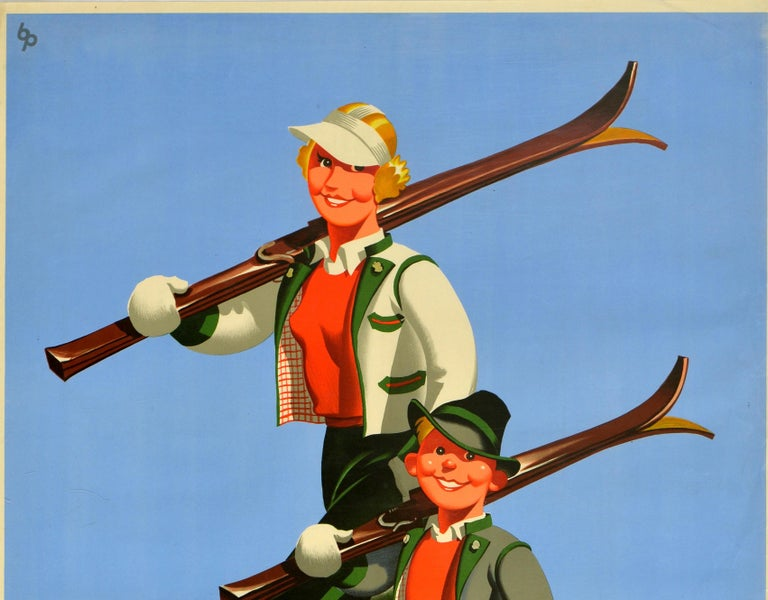 Original vintage winter sport travel and ski poster for Autriche / Austria featuring a great image of a smiling young boy and his mother looking towards the viewer as they walk on the snow in their skiing clothes, carrying their wooden skis over
