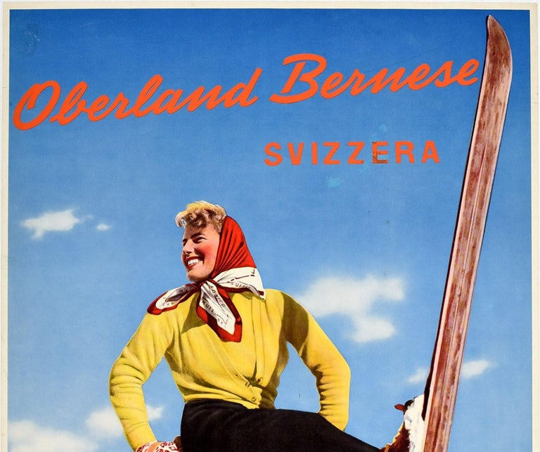 Original vintage ski travel poster - Oberland Bernese Svizzera - featuring a colourful image of a smiling lady in a headscarf leaning back on her poles and holding one ski up in the snow with trees in the background and the stylised lettering across