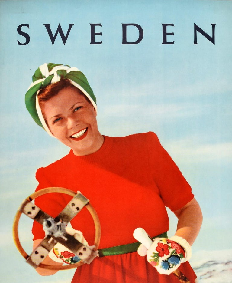Original vintage ski travel poster for Sweden featuring a fun image of a smiling lady wearing a bright red, white and green dress with a head scarf and floral patterned gloves standing on a snowy mountain and pointing a wooden ski pole at the