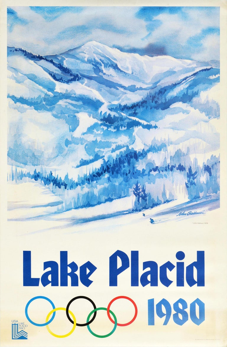 Original vintage sports advertising poster for the XIII Olympic Winter Games Lake Placid 1980 held in New York USA from 13-24 February featuring a stunning view by the American watercolour artist John Gallucci (1918-2009) showing skiers skiing on a
