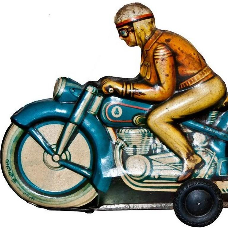 This friction motorcyclist is a vintage tin toy.