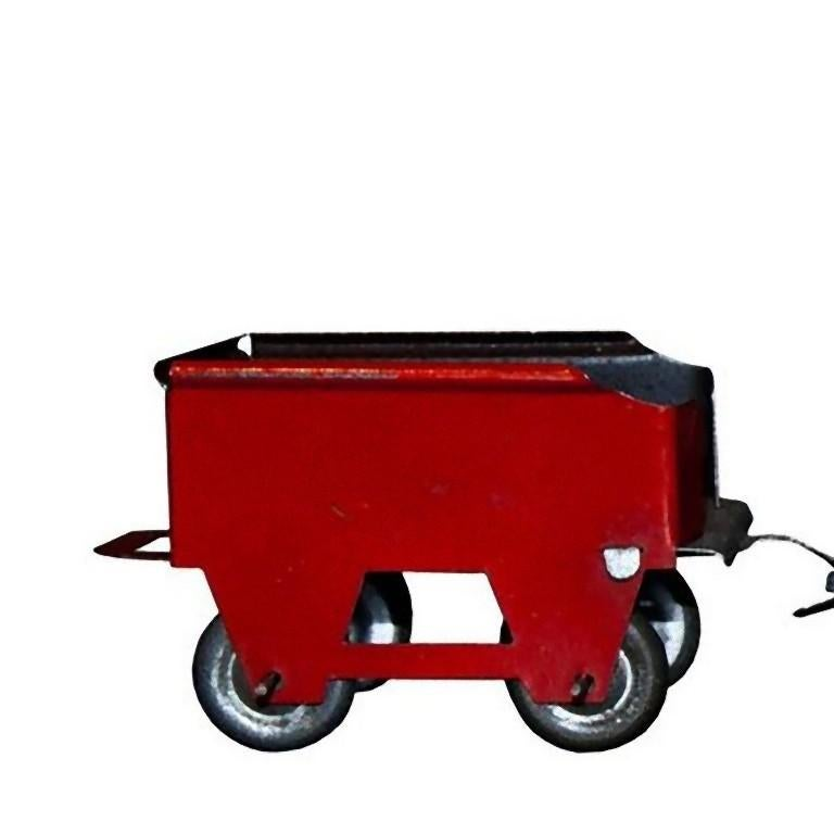 This small train and trailer is an original vintage toy.  This vintage toy train and its trailer was maybe part of a bigger set.  Unknown manufacturer, probably made in 1920s.  Very good conditions.  This object is shipped from Italy. Under