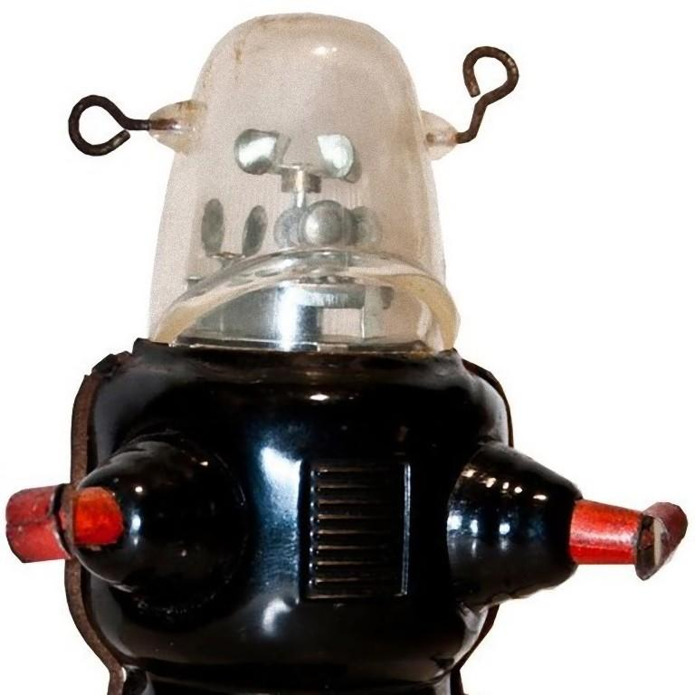 This wind up Robby the robot is a mechanical vintage toy.  Vintage wind up mechanical toy reproducing Robby the Robot Space Trooper.   1950s version, made in China. After being wind up, it walks forward while the radar spins inside its