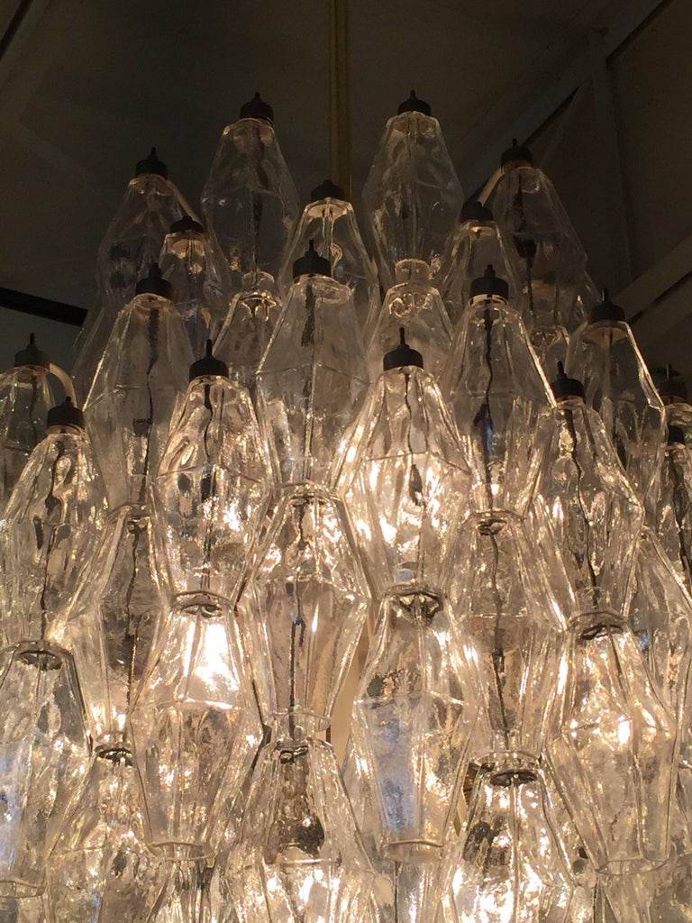 Designed by Carlo Scarpa for Venini, this all clear glass Murano polyhedral chandelier has an upgraded unlacquered brass rod and canopy. 15 sockets and bulbs (E-14 bulbs) - all original with caps and re-wired for US. Beautiful and elegant on or off,