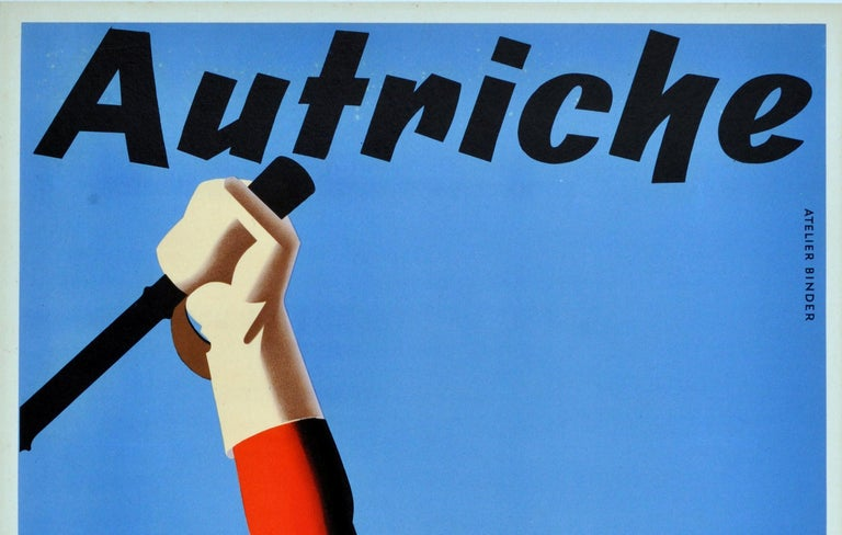 Original vintage skiing poster for Autriche (Austria). Great image featuring a smiling skier holding one pole up in the air with snowy mountains and trees in the background and a clear blue sky above. Very good condition, minor restored tears and