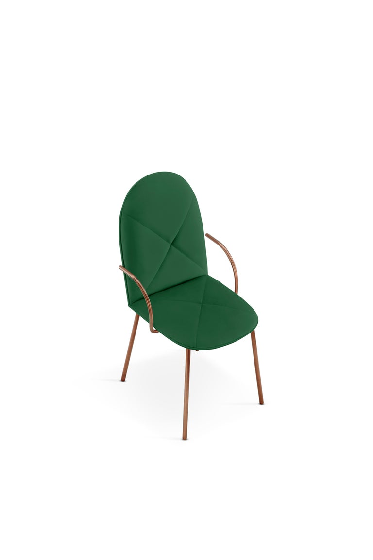 Designed by Nika Zupanc for the 88 Secrets Collection, this beautifully hand crafted Orion dining chair is featured here in a emerald green velvet upholstery and finished in rose gold metal.   The seat, ideal as a dining chair yet, easily translates