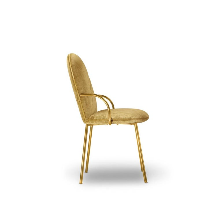 Designed by Nika Zupanc for the 88 Secrets Collection, this beautifully hand crafted Orion dining chair is featured here in a royal gold velvet upholstery from the Dedar Milano collection and finished in gold metal.   The seat, ideal as a dining