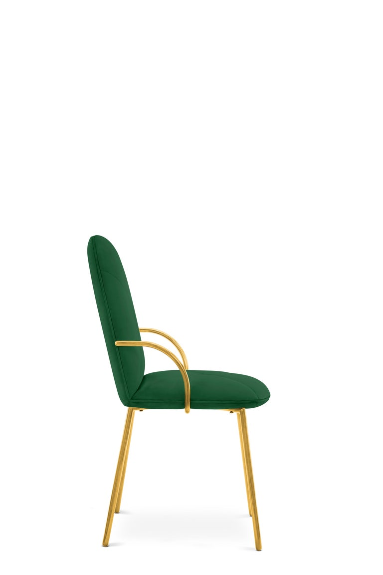Designed by Nika Zupanc for the 88 Secrets Collection, this beautifully hand crafted Orion dining chair is featured here in a royal emerald upholstery and finished in gold metal.   The seat, ideal as a dining chair yet, easily translates as an