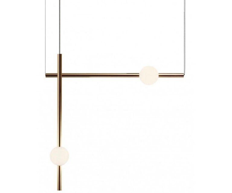 Orion comprises simple modular lights with opposing opaque and solid polished gold spheres along with opaque and solid gold tubes. These connect and expand horizontally and vertically to create bespoke constellations of light with infinite