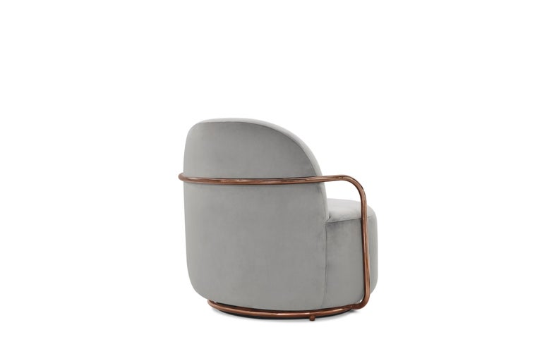 Orion Lounge Chair with Plush Gray Velvet and Rose Gold Arms by Nika Zupanc has timeless appeal in light gray velvet and rich rose gold metal arms.  Nika Zupanc, a strikingly renowned Slovenian designer, never shies away from redefining the status