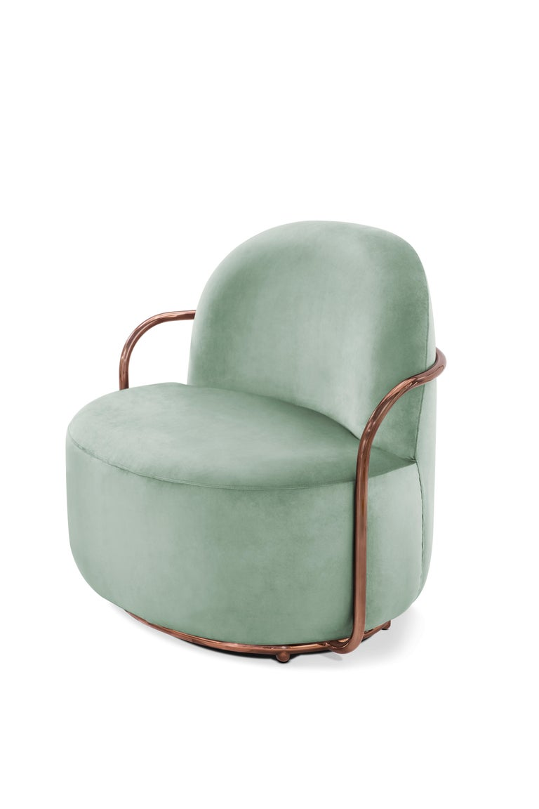The comfort of Orion Lounge Chair with Plush Mint Green Velvet and Rose Gold Arms by Nika Zupanc compliments the cool mint green velvet and rose gold metal arms.  Nika Zupanc, a strikingly renowned Slovenian designer, never shies away from