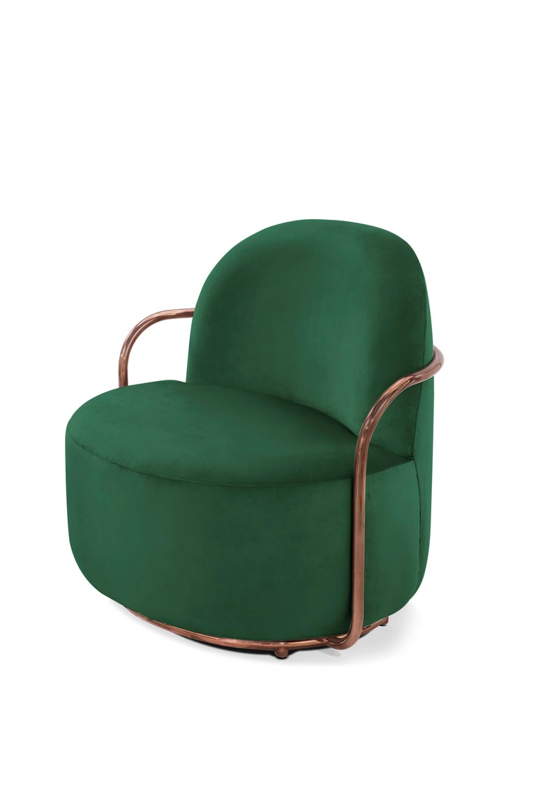 The rich deep green velvet contrasted with rose gold metal arms accentuates the fluid lines of the Orion Lounge Chair with Plush Green Velvet and Rose Gold Arms by Nika Zupanc.  Nika Zupanc, a strikingly renowned Slovenian designer, never shies away