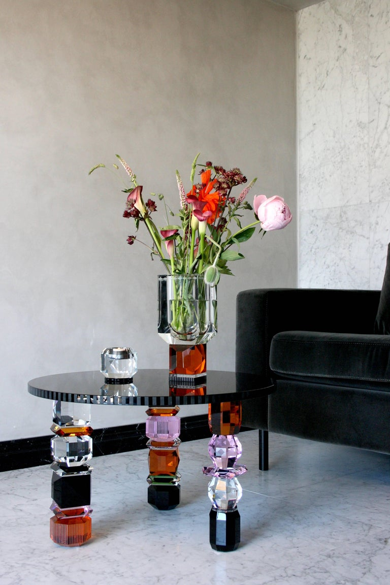 Orlando contemporary crystal table hand-sculpted contemporary crystal Crystal table Handcrafted decor made from crystal Measures: L 60 x H 39.5 x D 60 cm Handsculpted in crystal and glass  Eclectic style meets eccentric glam. The Orlando table