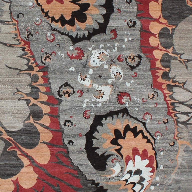 "This Orley Shabahang signature ""Synergy"" carpet in pure handspun wool and organic dyes showcases a contemporary design in a hand-knotted Persian weave. From the Orley Shabahang Galaxy series, this carpet depicts the similarity of the swirling power"