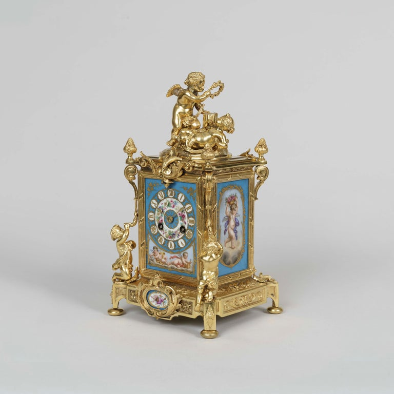 French Ormolu and Sèvres Style Porcelain Mounted Clock Set in the Louis XVI Manner For Sale