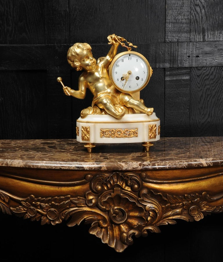 Ormolu and White Marble Antique Clock, Putto Floating in Clouds Playing a Drum For Sale 3