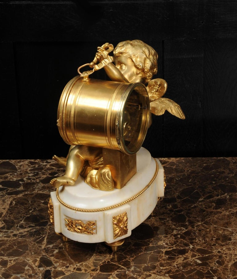 Ormolu and White Marble Antique Clock, Putto Floating in Clouds Playing a Drum For Sale 5