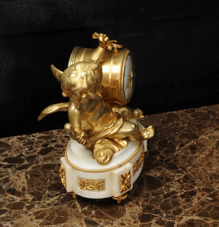 Ormolu and White Marble Antique Clock, Putto Floating in Clouds Playing a Drum For Sale 6