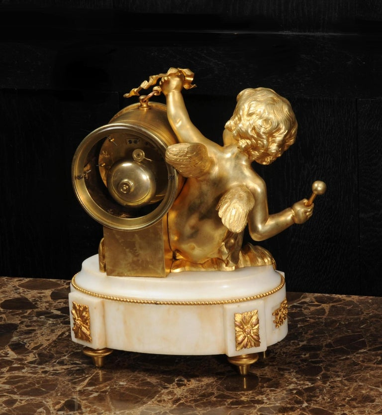 Ormolu and White Marble Antique Clock, Putto Floating in Clouds Playing a Drum For Sale 8